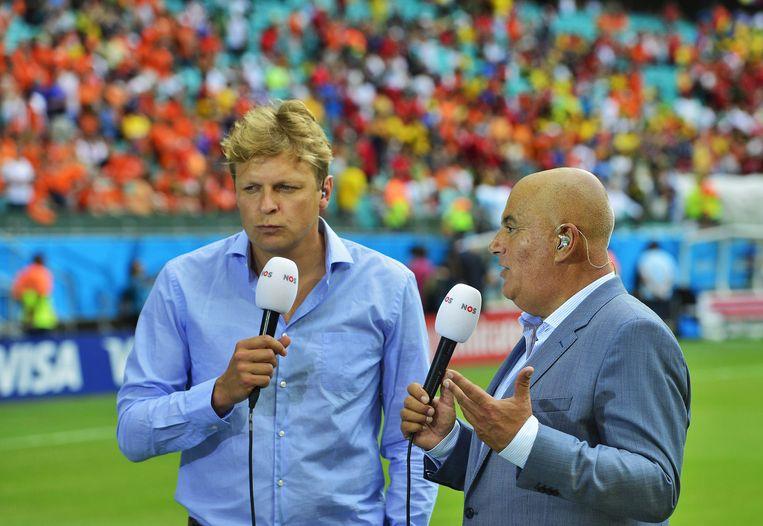 Youri Mulder en Jack van Gelder tijdens het WK voetbal in 2014. Beeld anp