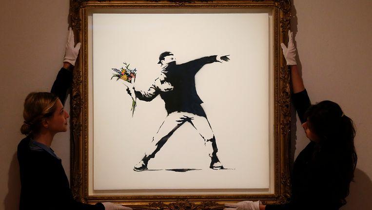 Een werk van Banksy werd in 2013 geveild in Londen. Beeld ap