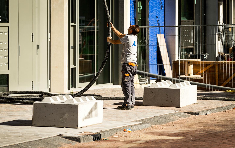Een bouwproject in Amsterdam. Er wordt wel gebouwd, maar lang niet genoeg om aan de grote vraag te voldoen.