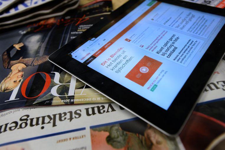 Blendle op de iPad. Aanvankelijk kon in de digitale kiosk een tegoed gekocht worden waarmee individuele artikelen uit tal van kranten en tijdschriften konden worden gelezen. Sinds vorig jaar is Blendle overgestapt op een 'all you can eat' abonnementsmodel Beeld ANP