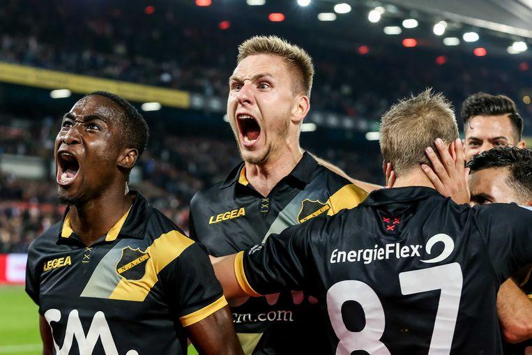 NAC-spelers vieren de 0-2 tegen Feyenoord. Beeld ANP Pro Shots