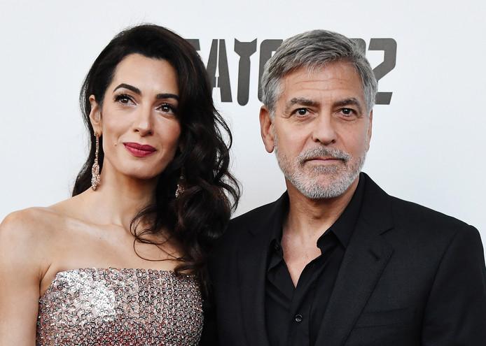 Amal samen met haar man George Clooney