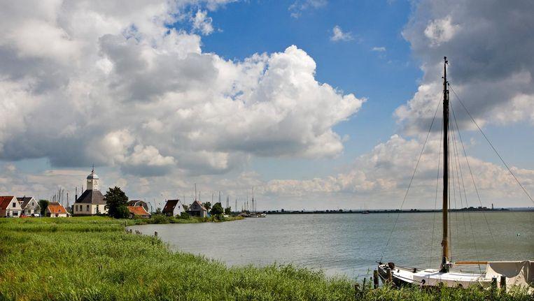 Wolkenlucht in de omgeving van Durgerdam. Beeld anp