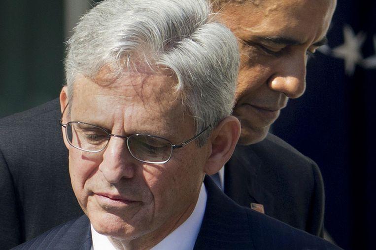 Merrick Garland met op de achtergrond Barack Obama. Beeld ap