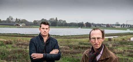'Red het platteland van Maas en Waal met windmolen en zonnepaneel'