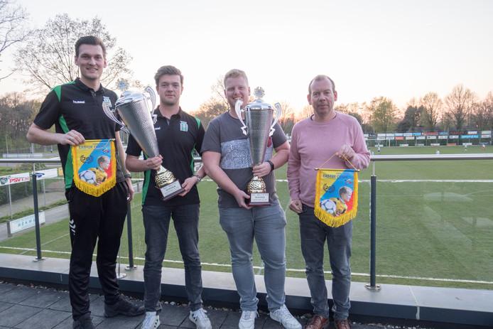 De organisatoren van het Easter Open-voetbaltoernooi bij SV Gramsbergen met vaantjes en trofeeën. V.l.n.r. Rik Westerhof, Nick Altena, Thomas Grotemarsink en Dirk-Jan Braker.