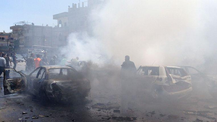 De ravage van de aanslag in Homs.