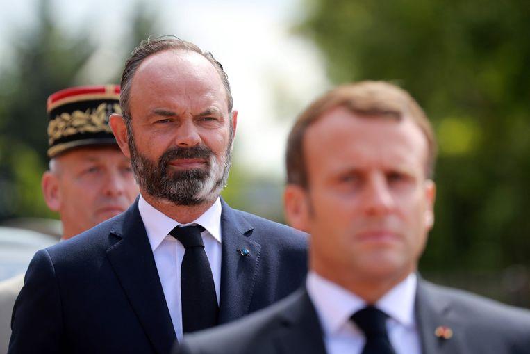 De Franse eerste minister Edouard Philippe, hier achter president Emmanuel Macron.