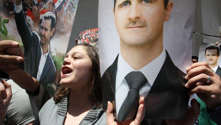 Syrische supporters van president Bashar al-Assad Beeld AFP
