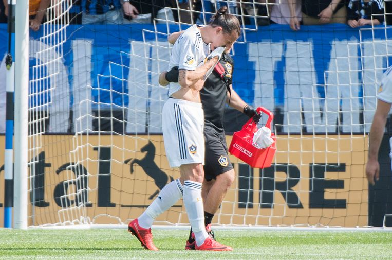 L.A. Galaxy's Zlatan Ibrahimovic is helped off the pitch during first-half MLS soccer game action against the Montreal Impact in Montreal, Monday, May 21, 2018. (Graham Hughes/The Canadian Press via AP)