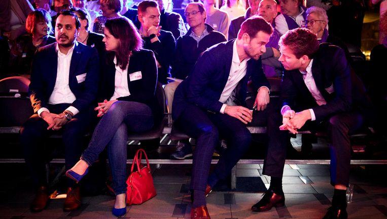 (VLNR) Nourdin el Ouali (lijsttrekker Nida), Barbara Kathmann (lijsttrekker PvdA), Sven de Langen (lijsttrekker CDA) en Vincent Karremans (lijsttrekker VVD) voorafgaand aan een debat in de Centrale Bibliotheek daags voor de gemeenteraadsverkiezingen. Beeld anp