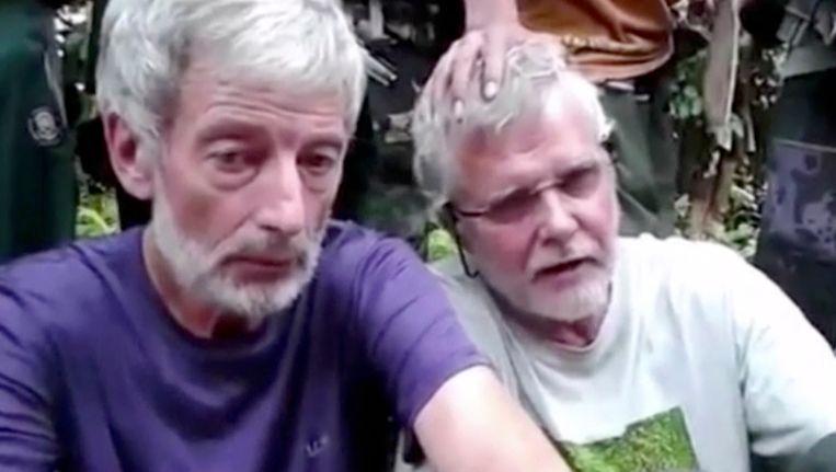 De Canadezen John Ridsdel (rechts) en Robert Hall. Beeld ap