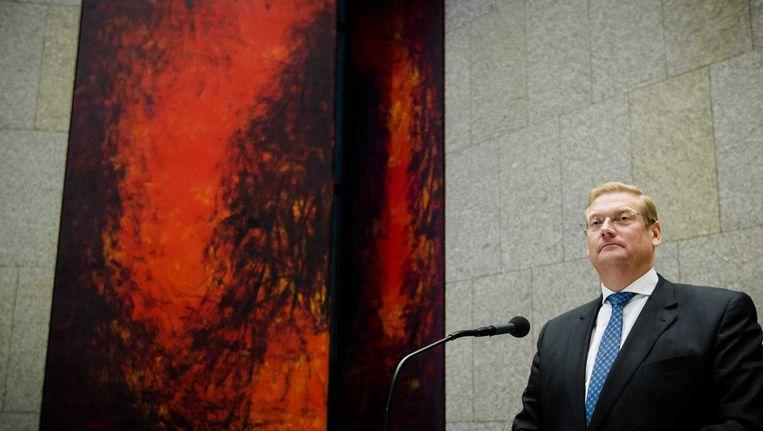 Minister Van der Steur beantwoordt de Kamer in het debat over de Volkertfoto. Beeld anp