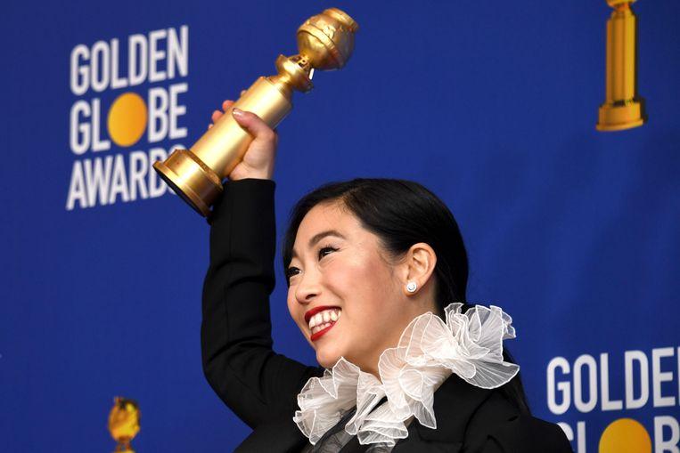 Awkwafina heeft zondag geschiedenis geschreven door een Golden Globe te winnen. Ze is de eerste actrice van Aziatische afkomst die een award won in een van de categorieën voor beste actrice. Beeld EPA