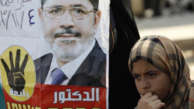 Een supporter van de verdreven president Mohamed Morsi. Beeld reuters