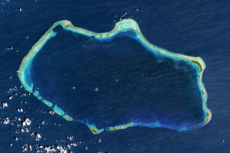 Satellietbeeld van het atol Bikini, een van de Marshalleilanden. De Marshalleilanden bestaan uit 29atollen, ringvormige eilandenreeksen, die samen 1.200 eilandjes omvatten.