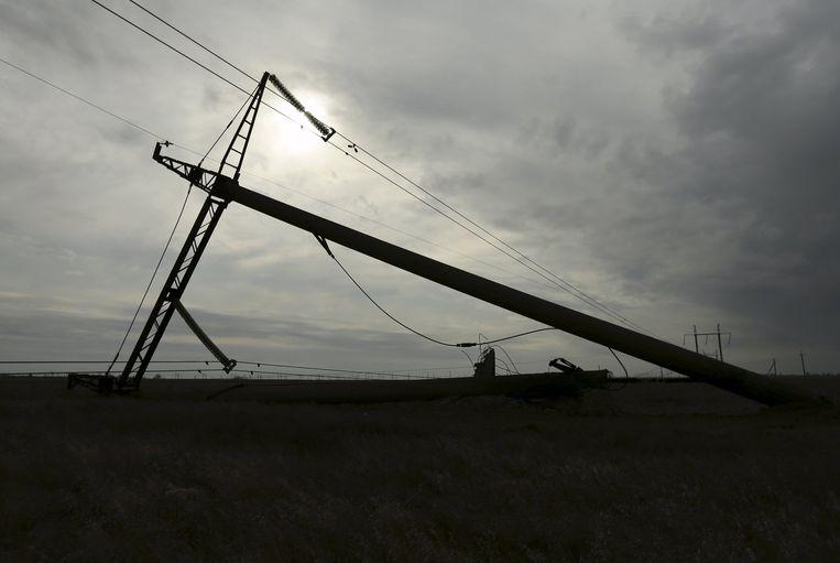 Een omgevallen elektriciteitsmast op de Krim. Beeld afp