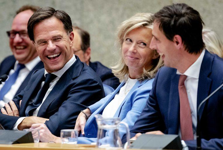 Premier Mark Rutte, minister Kajsa Ollongren van binnenlandse zaken en koninkrijksrelaties (D66) en minister Wopke Hoekstra van financiën (CDA) tijdens de Algemene Politieke Beschouwingen.  Beeld ANP