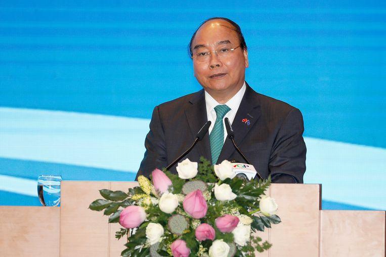 De Vietnamese premier Nguyen Xuan Phuc spreekt tijdens de bijeenkomst met de Europese Unie om het vrijhandels- en investeringsverdrag te tekenen.  Beeld EPA