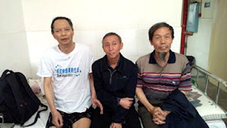 Li Wangyang (l) op een foto die maandag werd gemaakt door vrienden in Shaoyang. Beeld afp