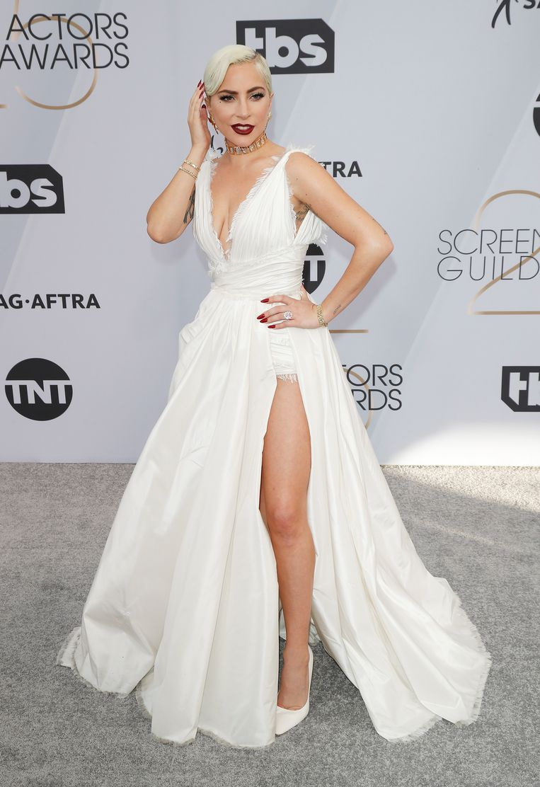 Lady Gaga in a dress by Dior Haute Couture and heels by Jimmy Choo.
