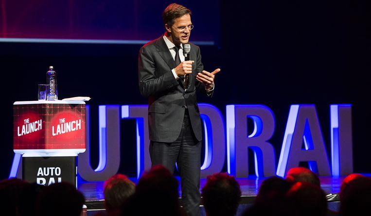 Premier Mark Rutte spreekt op de AutoRAI, tijdens de officiële opening. Beeld anp