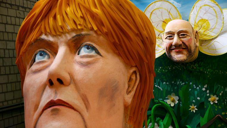 Carnavalskoppen van de Duitse bondskanselier Angela Merkel en Martin Schulz. Beeld reuters