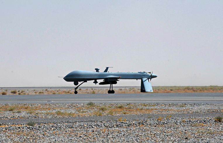 Een drone die in staat is om precisieaanvallen met raketten uit te voeren op een militair vliegveld in Kandahar. Beeld reuters