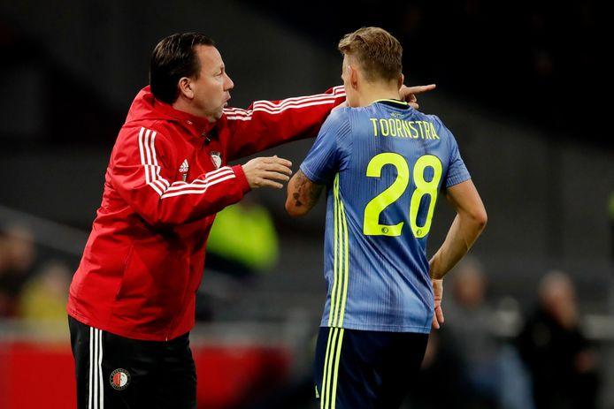 Jean-Paul van Gastel (links) geeft instructies aan Jens Toornstra.