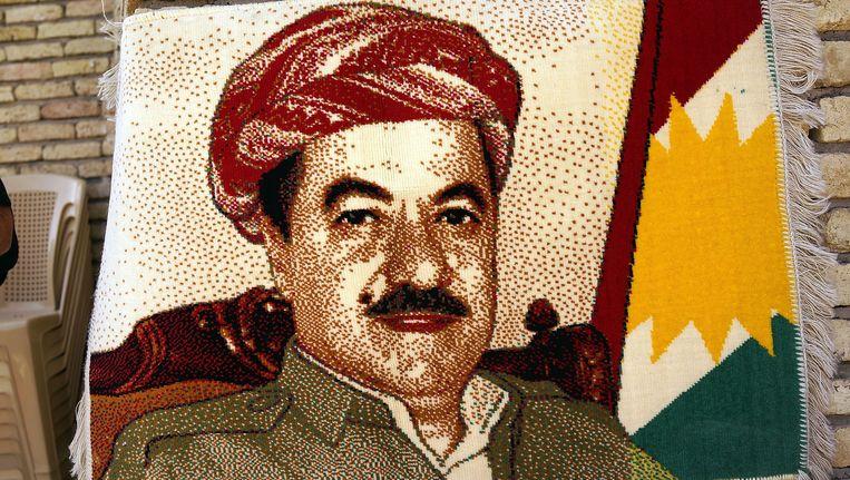 Een tapijt met een afbeelding van de Koerdische leider Massoud Barzani. Beeld getty