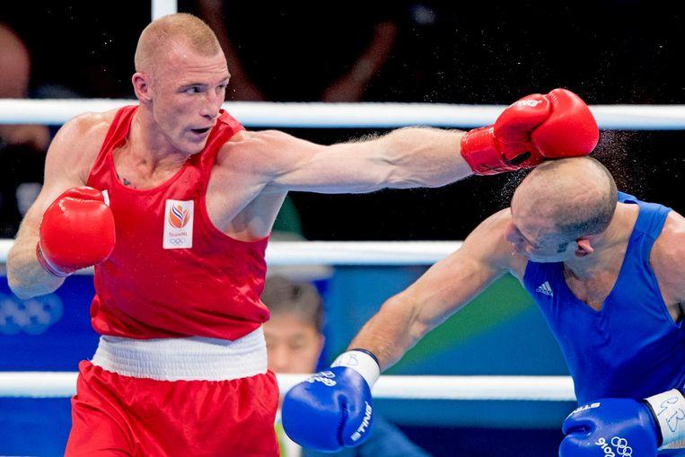 Peter Mullenberg in actie tegen Ehsan Rouzbahani uit Iran tijdens het bokstoernooi in Riocentro tijdens de Olympische Spelen van Rio Beeld anp