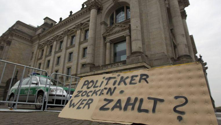 Protestbord voor het Duitse parlement. Beeld reuters