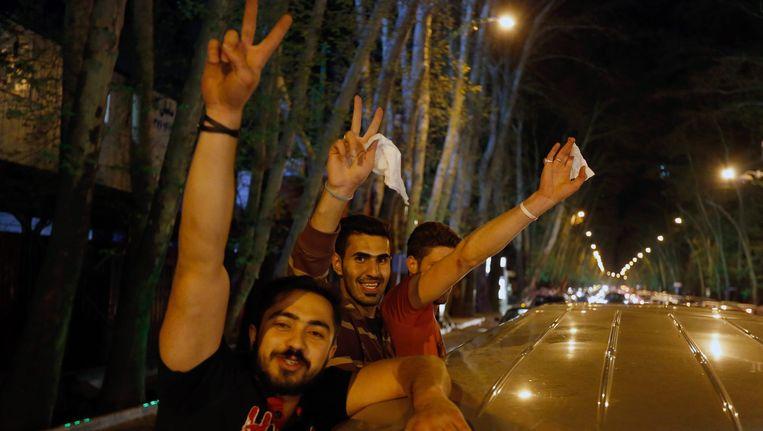 Iraniërs vieren feest in Teheran na de nucleaire top. Beeld ANP