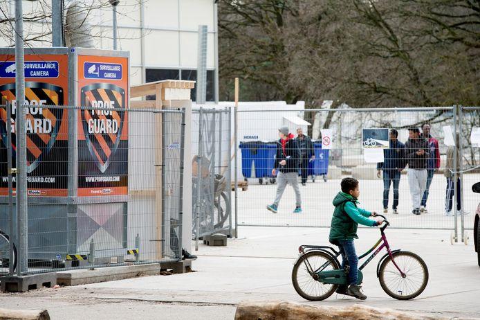 Syrische vluchtelingen in een asielzoekerscentrum in Nederland.