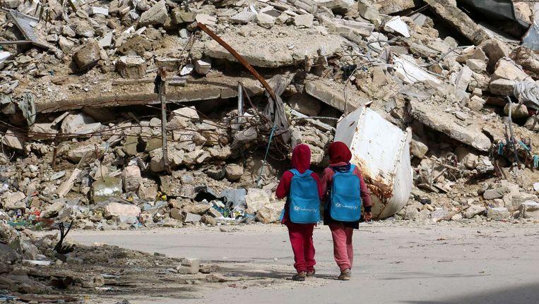 Syrische schoolmeisjes in Aleppo. Beeld afp