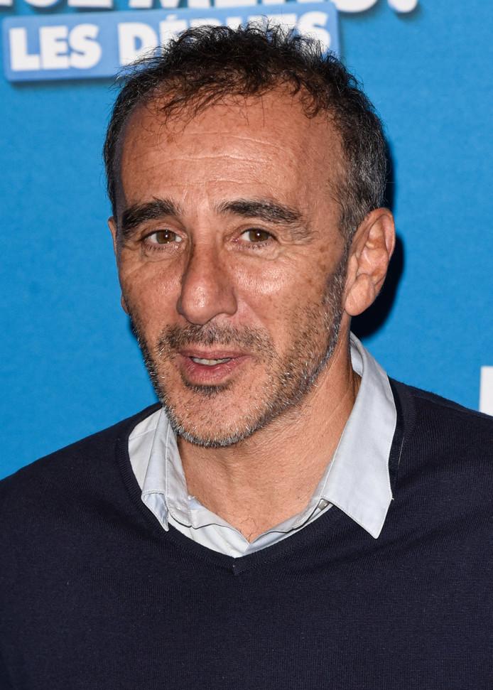 """Elie Semoun lors du photocall pour l'avant-première du film """"La vérité si je mens"""" le 15 octobre à Paris."""