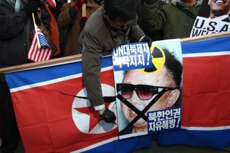 Zuid-Koreanen zijn woedend op hun bovenbuurman na de aanval op een Zuid-Koreaans schip. ANP Beeld