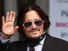 Johnny Depp toont foto's vernielde keuken in rechtbank, zegt dat Heard ravage aanrichtte