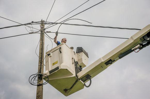 Ondersteunend beeld: een man in een hoogtewerker.