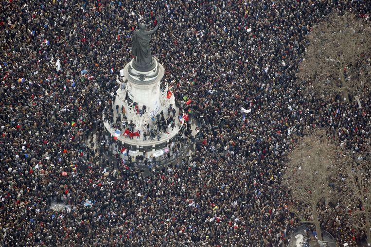 De mars in Parijs na de aanslag op de redactie van Charlie Hebdo en de joodse supermarkt, afgelopen januari. Beeld afp