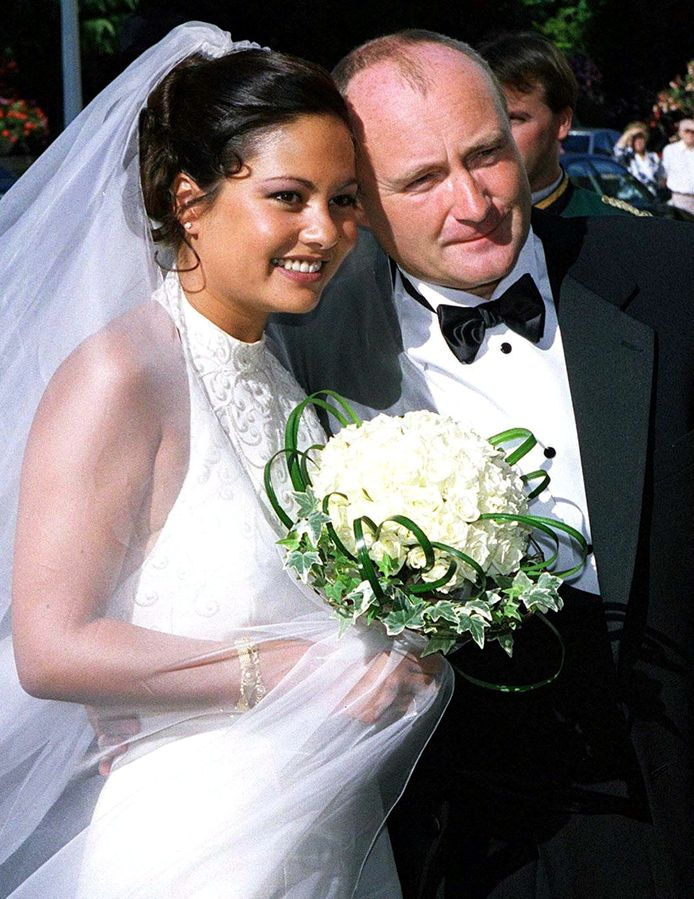 Phil Collins en Orianne Cevey in 1999.