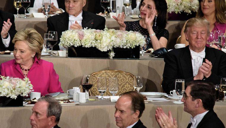 Hillary Clinton en Donald Trump bij het New Yorkse gala. Beeld afp
