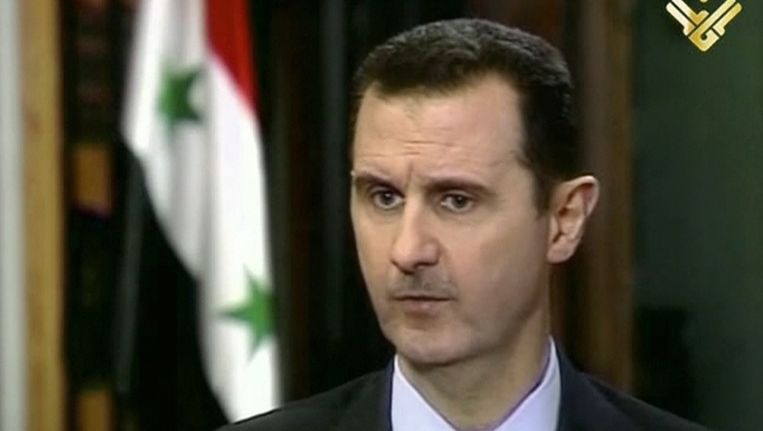 Screenshot van het interview met Assad op Al-Manar. Beeld AP