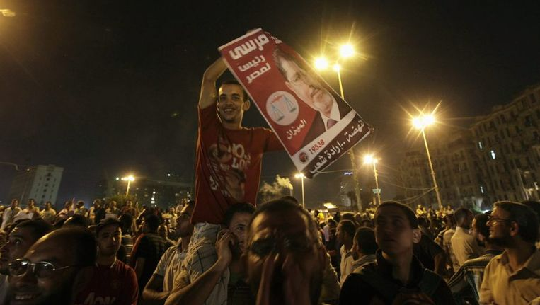 Aanhangers van president Mursi op het Tahrirplein Beeld reuters