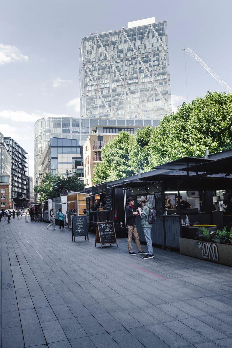 Spitalfields Market, in normale tijden een mengelmoes van kantoormensen, toeristen en creatievelingen. Beeld Carlotta Cardana