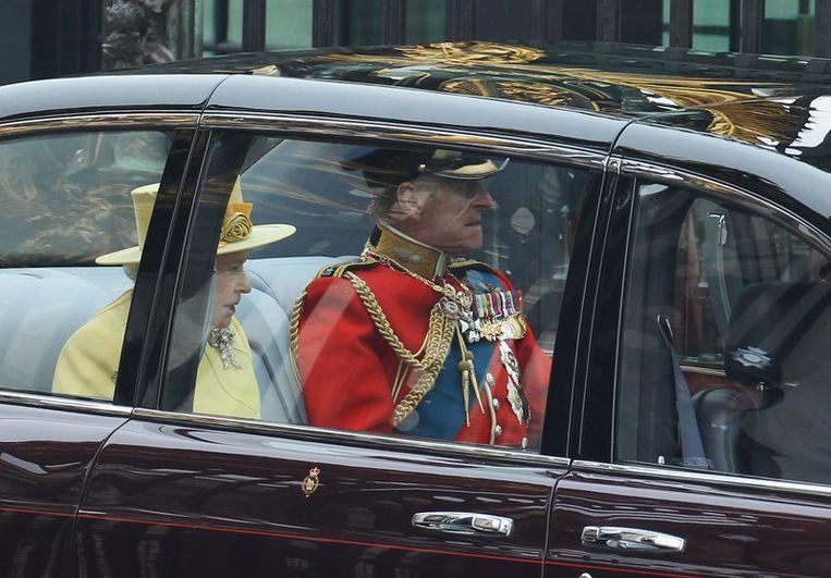 Koningin Elizabeth met haar man Philip. Beeld getty