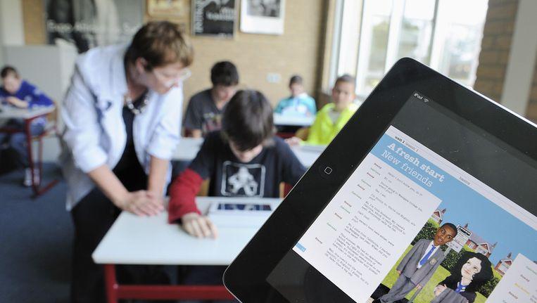 Leerlingen met iPads in de klas Beeld Archieffoto ANP