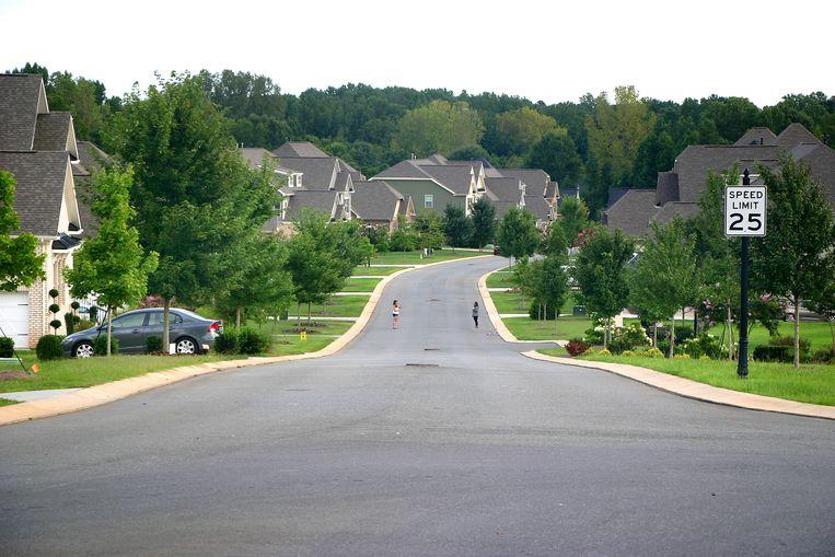 De 'gated community' Highclere, een van de vele rijke voorsteden rond Charlotte.  Beeld Michael Persson