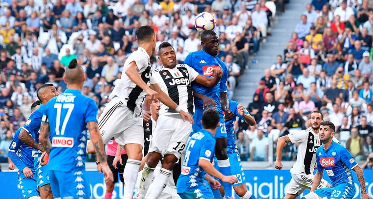 Juventus' Alex Sandro and Napoli's Kalidou Koulibaly, top right, jump for the ball during the Serie A soccer match between Napoli and Juventus at the Allianz Stadium in Turin, Italy, Saturday, Sept. 29, 2018. (Alessandro Di Marco/ANSA via AP)
