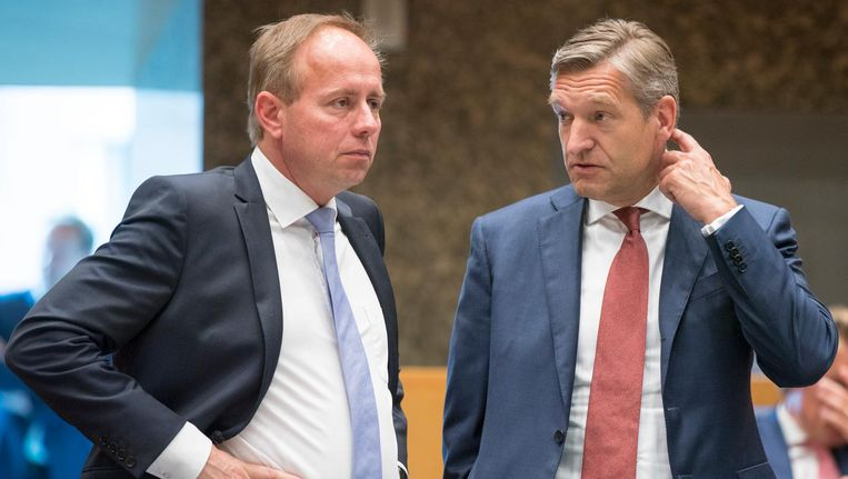 SGP'er Kees van der Staaij naast CDA'er Sybrand Buma in de Kamer. Beeld anp